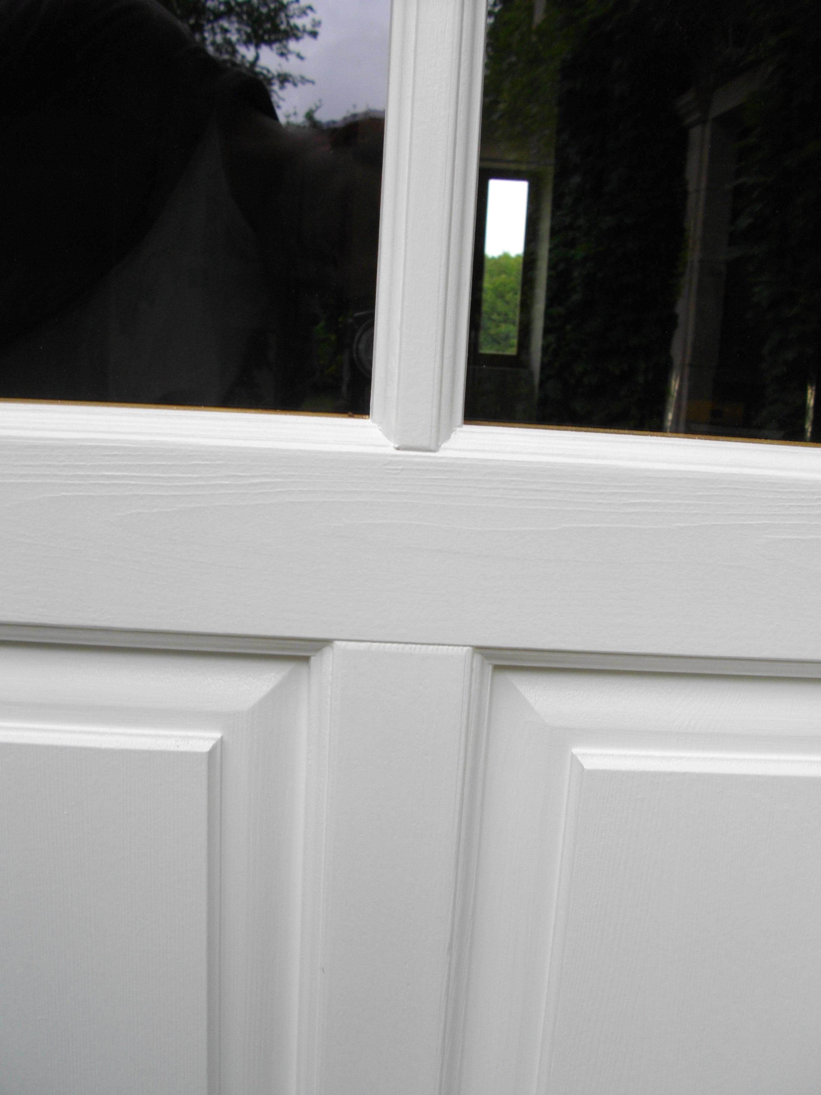 détail assemblage traverse-montant petit bois et panneaux-porte-exterieur chêne massif peinte en blanc